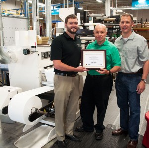 Brian Mirr (left) of the Wisconsin Safety Council, presents TLP's Mark Little, Operations Manager (center) and Jeff Kerlin, President & COO (right) with a certificate recognizing Tailored Label Products' achievement of having reached 10 years and 1.3 million work hours without a Lost Time Accident.