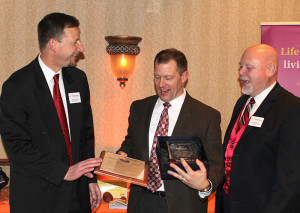 TLP President and CEO Jeff Kerlin accepts Captain of Industry Award on behalf of company